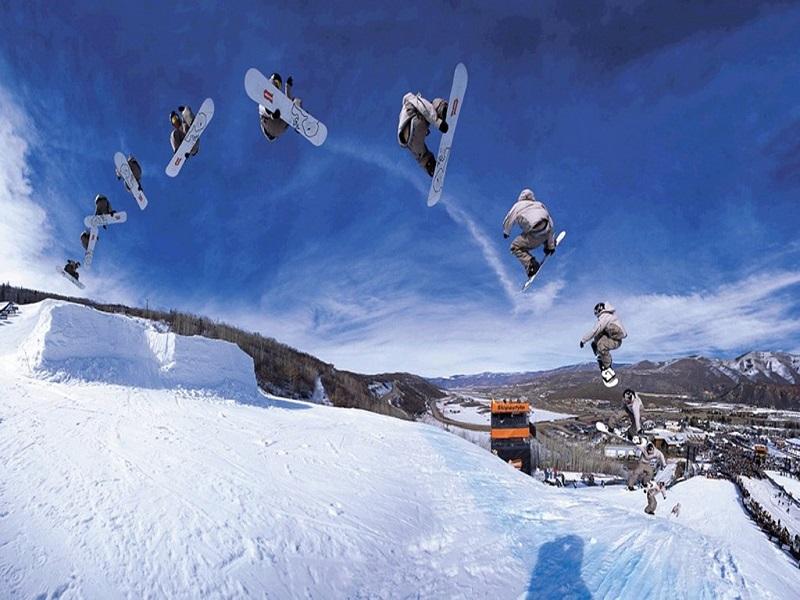 salto snowboard múltiple imagen