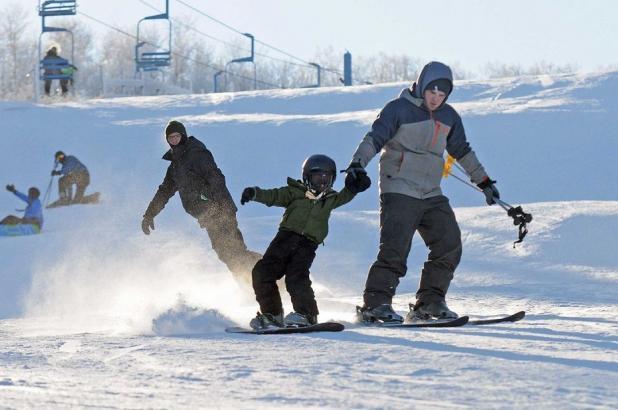 Aprendiendo a hacer snowboard en Huff Hills